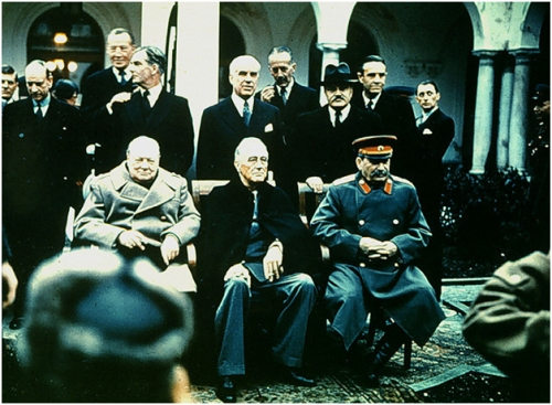 Even Averell Harriman, standing above Stalin, is not smiling.